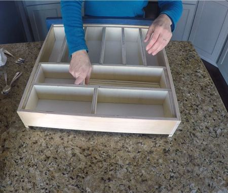 Insert dividers and tension will hold them into place in this organizer