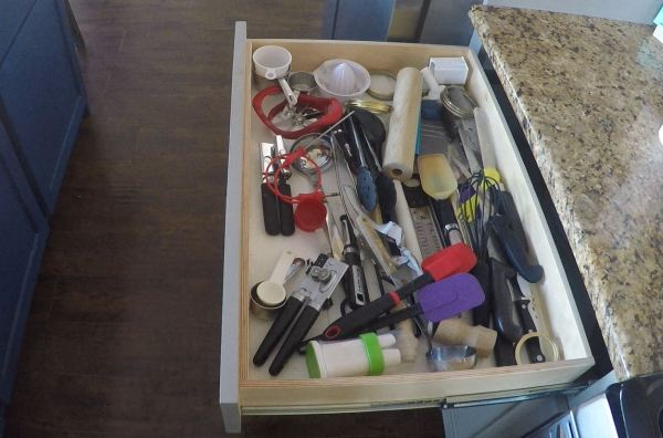Messy drawers be gone. A simple no nails or glue solution with a utensil drawer organizer featured on Remodelaholic.com