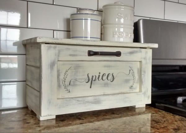 This DIY countertop spice storage bin features a tilt-out drawer and faux shiplap sides for stylish kitchen organizing! Plus, get the free printable spice drawer label and round spice bottle labels in two styles. Free building plan and printable space labels at #remodelaholic.