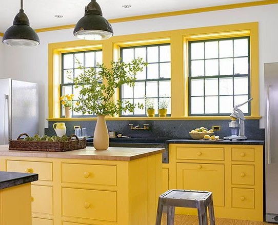 Bright yellow kitchen with soapstone counters via BHG | Yellow Kitchen Inspiration and decorating ideas #Remodelaholic