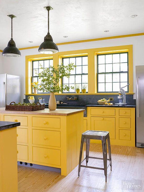 Bright yellow kitchen with soapstone counters | Yellow Kitchen Inspiration #Remodelaholic