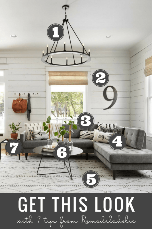 Get This Look: Fixer Upper Living Room from The Americana House   Recreate the iconic Joanna Gaines modern farmhouse chic style from the shiplap and neutral area rug to the chandelier and mid-century sofa with these tips, decorating picks, and DIY tutorials #getthislook #remodelaholic #fixerupper #modernfarmhouseGet This Look: Fixer Upper Living Room from The Americana House   Recreate the iconic Joanna Gaines modern farmhouse chic style from the shiplap and neutral area rug to the chandelier and mid-century sofa with these tips, decorating picks, and DIY tutorials #getthislook #remodelaholic #fixerupper #modernfarmhouse