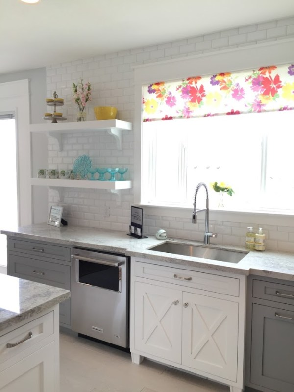 Sophisticated gray kitchen cabinets, with a white farmhouse style accent cabinet for the sink, and colorful decor #remodelaholic #getthislook