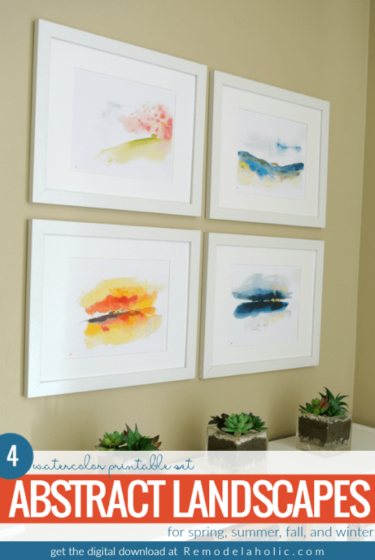 Add beautiful color and style to your wall art with this printable set of abstract watercolor landscapes with gold foil accents. 4 seasonal prints can be displayed together as a collection or swapped out to match the season outside. #remodelaholic #printableartcollection #gallerywall
