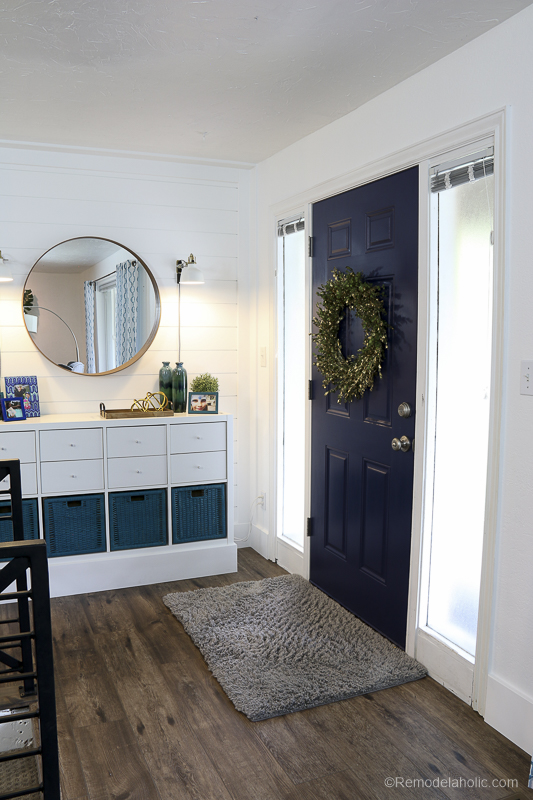 26 Tips for How to Paint Interior Doors -- the right way, the first time! This FAQ for painting doors includes whether to use a brush vs. a roller, how to paint common affordable 6-panel hollow core doors, and how to get a smooth finish on a faux wood grain door. #remodelaholic