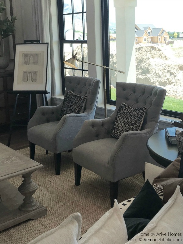 Gray Upholstered Arm Chairs In Living Room, Arive Homes And Brandalyn Dennis Design, 2018 Utah Valley Parade Of Homes, Featured On Remodelaholic