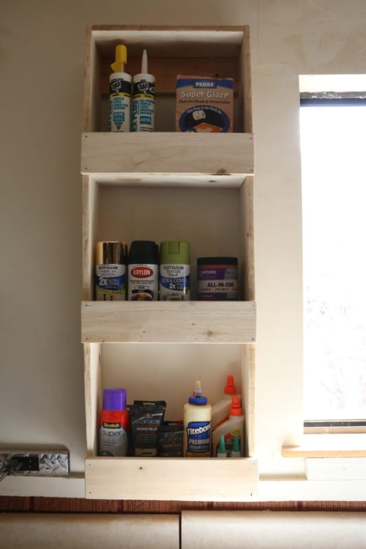 Easy To Build Rustic Wood Wall Bin For Garage Paint And Glue Storage #remodelaholic