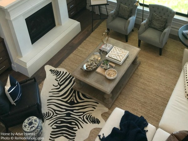 Jute Area Rug Gives Definition In Modern Farmhouse Great Room Arive Homes And Brandalyn Dennis Design 2018 Utah Valley Parade Of Homes Featured On Remodelaholic