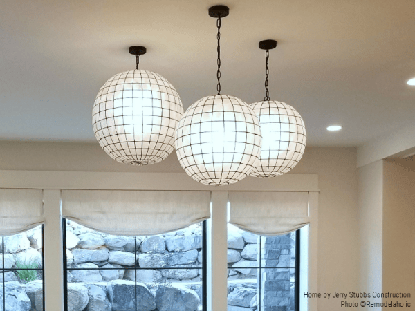 Set Of 3 Globe Lights Hung At Differing Heights In A Lower Level Family Room Jerry Stubbs And Tique And Co 2018 Utah Valley Parade Of Homes Featured On Remodelaholic