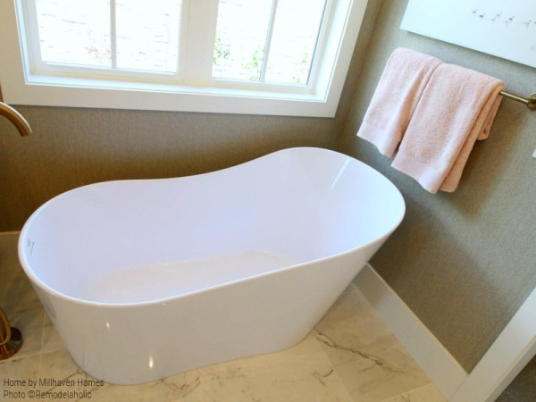 Double Slipper Freestanding Bathtub And Luxury Bath Towels In Master Bathroom, Millhaven Homes & Four Chairs Design, 2018 Utah Valley Parade Of Homes Featured On Remodelaholic