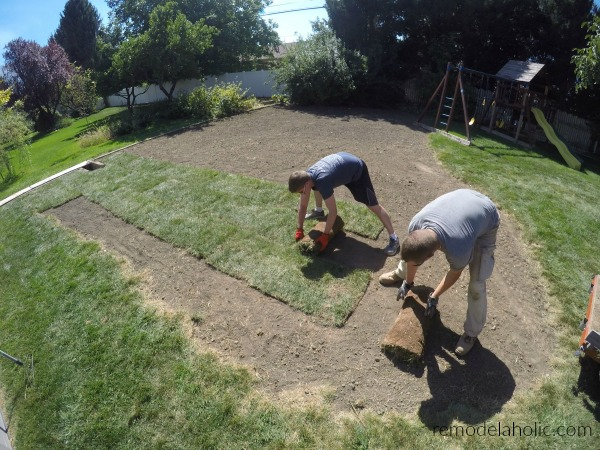 Unrolling Sod Pieces #remodelaholic How To Lay Sod Yourself