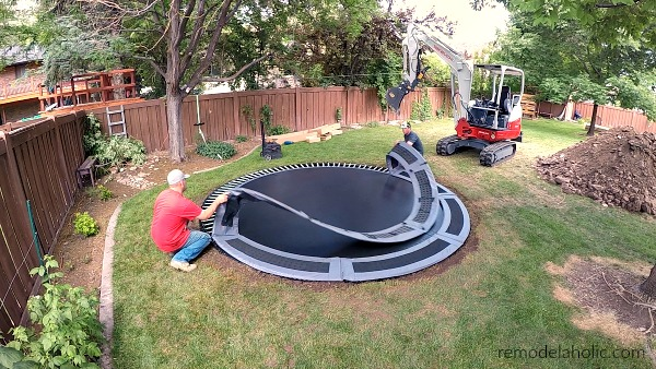 Adding The Trampoline Mat And Vented Pads To In Ground Trampoline #remodelaholic