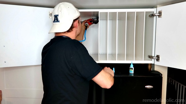 Glue And Nail Fridge Cabinet Organizer Divider Pieces In Place #remodelaholic