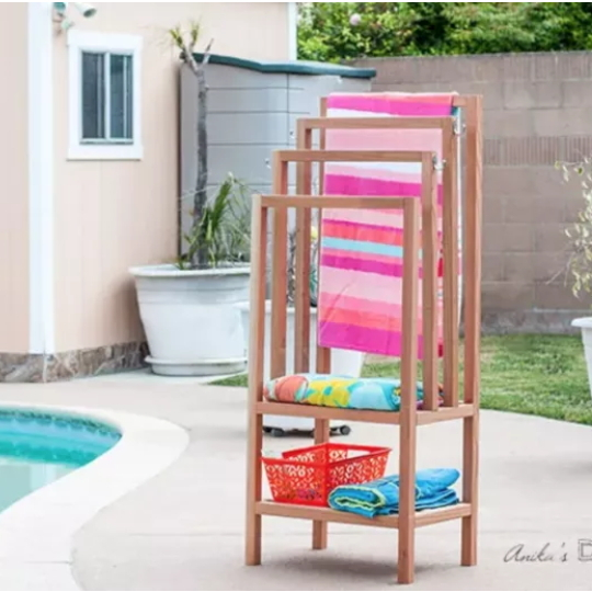 DIY Wooden Pool Stand Holding Colorful Towels And A Basket Of Toys