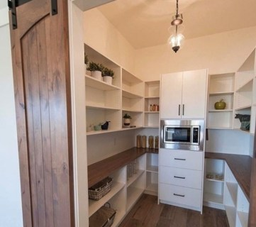 Stunning White Pantry With Shelves On Every Wall And Wooden Barn Door
