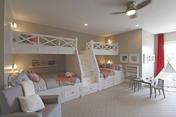 Built In Bunkbeds, White With Grey Bedding And Pink Blankets Qand Pillows With Stairs In The Middle Of The Four Bunkbeds