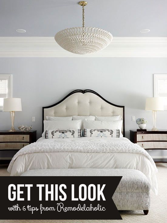 Grey Bedroom With White Trim And White Upholstered Bed With White Bedding