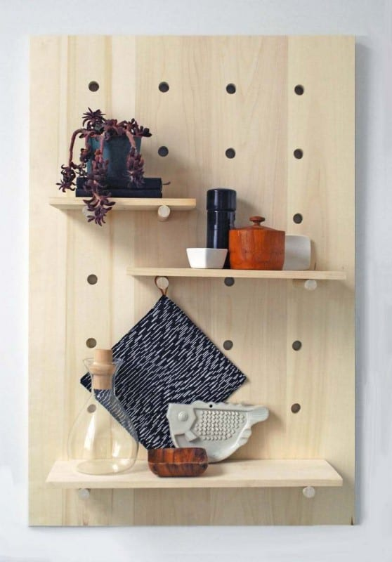 Plywood Pegboard With Adjustable Shelves And Colorful Ceramic Vases