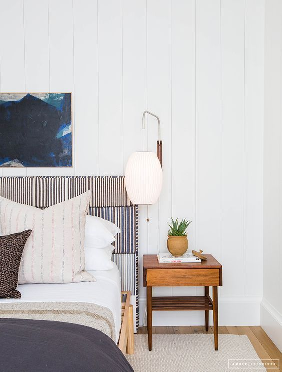 White Shiplap Wall With Natural Wood Night Stand, Blue Artwork Above Blue Striped Headboard Bed With Blue Comforter