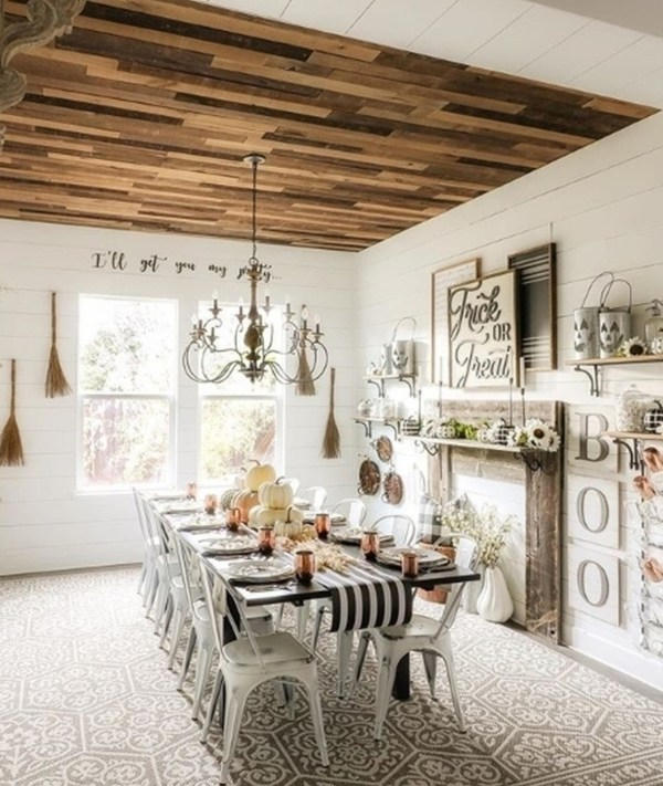 Patterned Floor With Long Rectangular Table With Every Sort Of Gorgeous Fall And Halloween Decor Surrounding The Room And Table