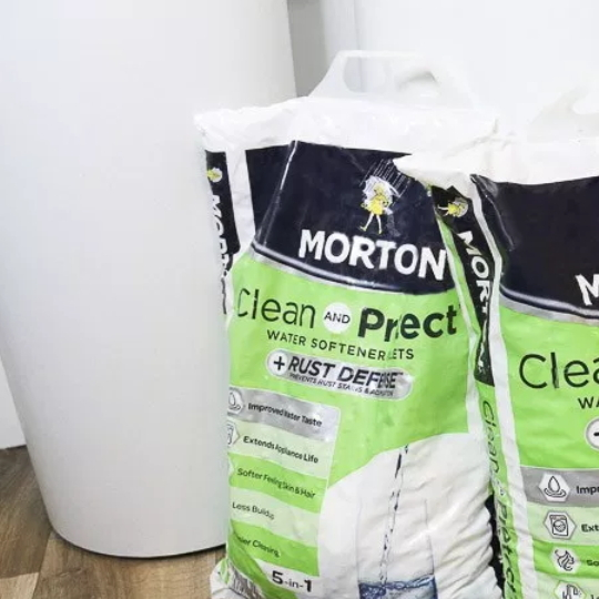 White Water Softener Base With Bags Of Morton Salt In Front