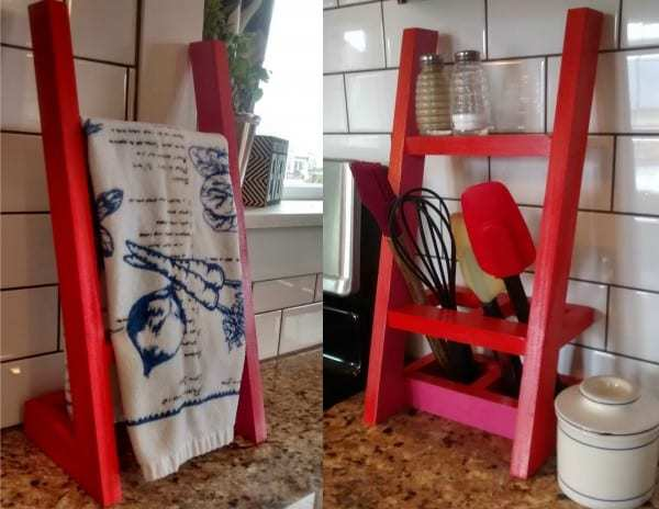 Red Towel Rack And Utinsel Holder Against White Tile Backsplash