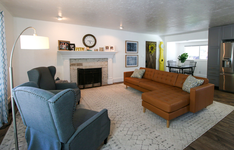 open concept floorplan living room before DIY fireplace makeover