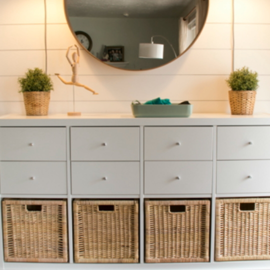 Organizing Your Entryway White Drawers With Wicker Baskets And Shiplap Wall Behind
