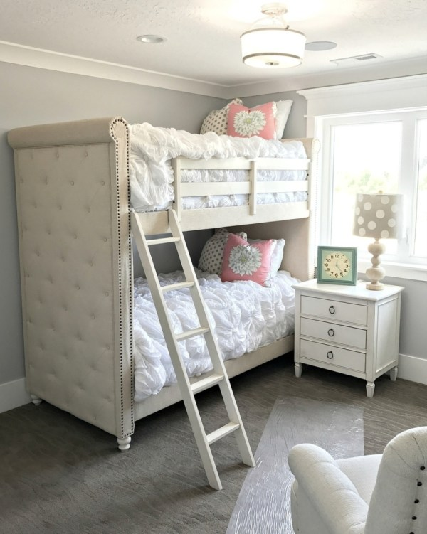 Plush Bunk Beds With Gorgeous Tufted White Bedspreads And Pink Floral And Polka Dot Pillows