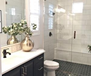 Tile Shower, Navy Vanity, Patterned Tile Floor, Glass Shower. Gold Vase Bathroom