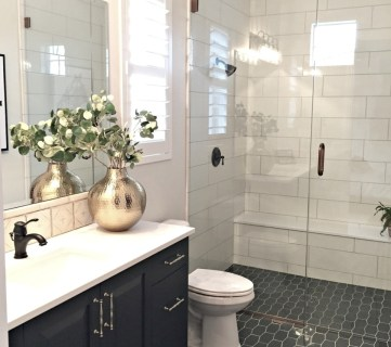 Tile Shower, Navy Vanity, Patterned Tile Floor, Glass Shower. Gold Vase Bathroom