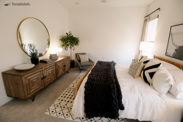 Black and White Tribal Area Rug in a neutral bedroom, SGPH 2019 House 22 SunRiver Construction, LC (75) Photo by Remodelaholic.com