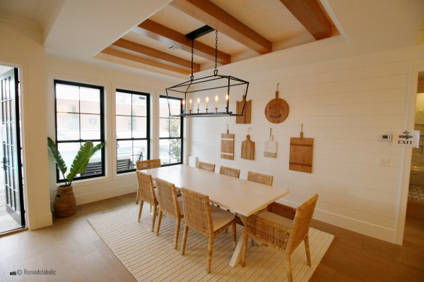 Natural and white dining room design with a pretty jute area rug. SGPH 2019 House 24 K Welch Homes (44) photo by Remodelaholic.com