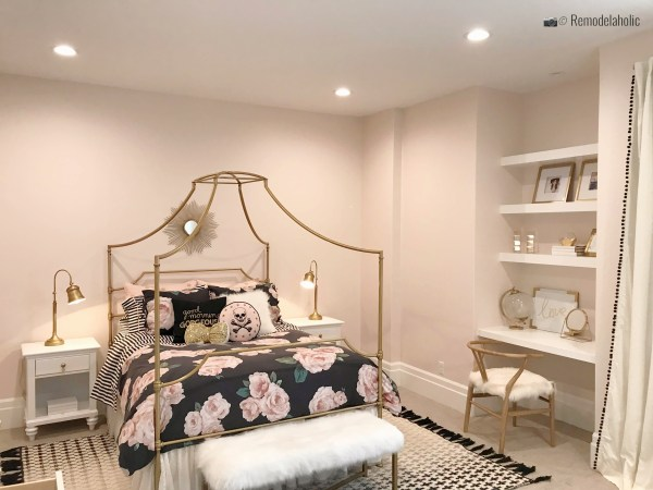 Metal four poster bed with a pretty floral bedspread, UVPH 2018 Home 30 Shelby Homes, Gatehouse No. 1 Furniture & Design, Photo by Remodelaholic