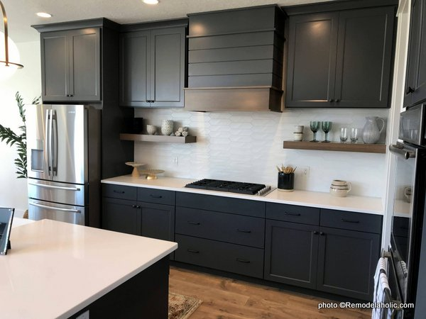 Modern dark gray kitchen cabinets with white backsplash open shelving beneath cabinets, UVPH 2018 Home 22 Mitchell Dean Homes,