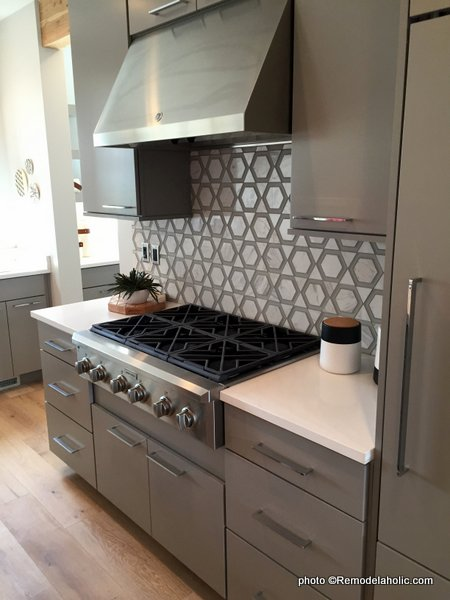 Modern Gray Kitchen Cabinets, Large Handles, Gray Pattern Tile Backsplash, UVPH 2016 Home 35 Emerald Homes