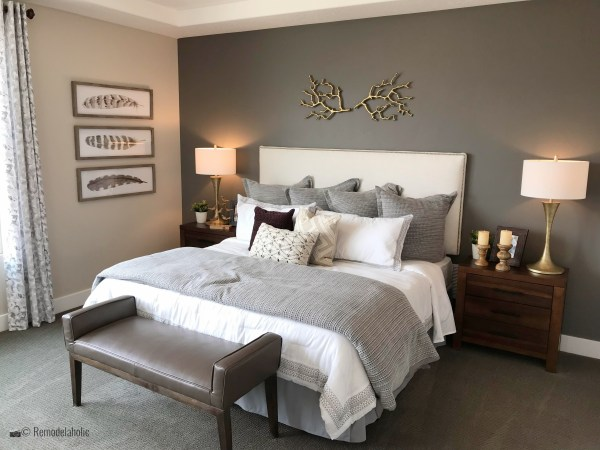 Elegant master bedroom with an upholstered headboard, SLPH 2018 Home 18 Oakwood Homes, Photo by Remodelaholic