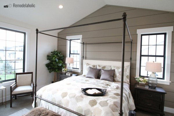 Black four poster bed frame with a fun shiplapped wall, SLPH 2018 Home 7 Wright Homes, Photo by Remodelaholic