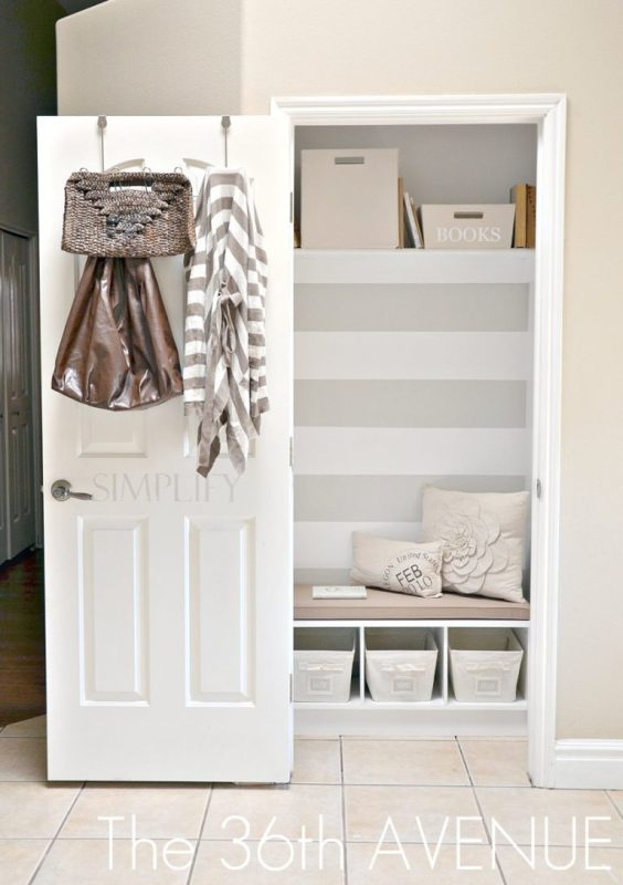 Small Closet With Bench, Cubbys, Baskets, Pillows, Shelf And Striped Wallpaper