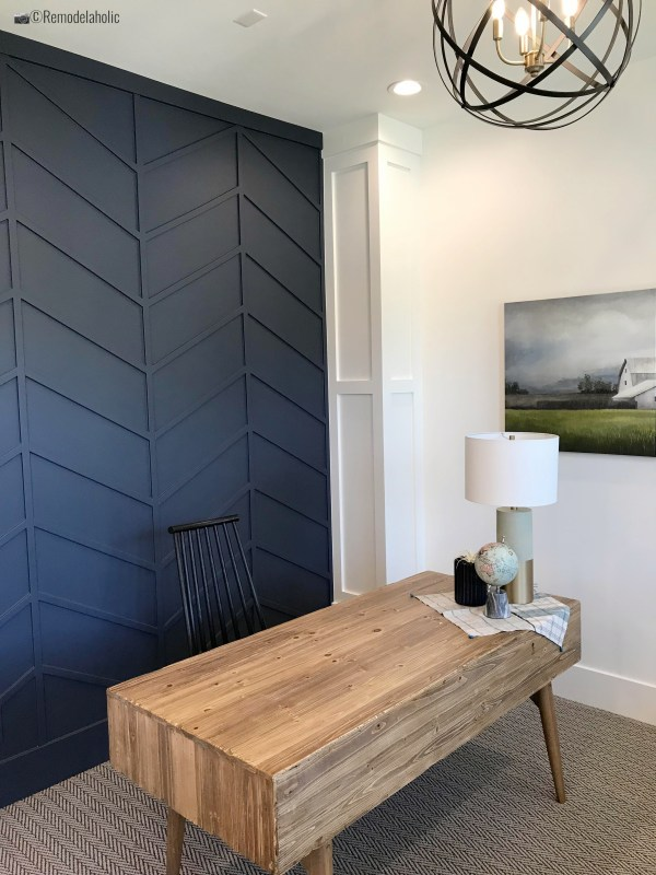 Navy fretwork wall in herringbone in a home office, UVPH 2018 Home 17 Millhaven Homes, Four Chairs Furniture & Design, Photo by Remodelaholic