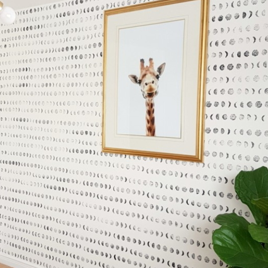 DIY Stamped Accent Wall Of Moons With Giraffe Picture In Gold Frame