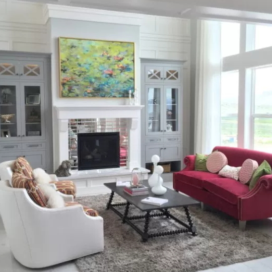 Living Room With Grey Cabinets, Red Sofa, Black Table And White Chairs