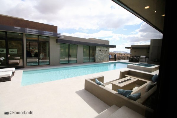 Add a sectional poolside for a place to relax. SGPH 2019 House 15 Split Rock Custom Homes, Photo by Remodelaholic