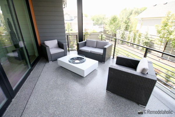 Small patio loveseat set up. SLPH 2018 Home 3 Breen Homes, Photo by Remodelaholic