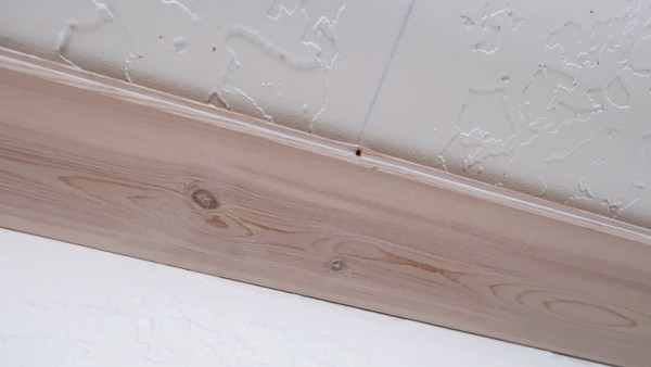 Installing Whitewashed Knotty Pine Boards On Ceiling Tongue Toward Entry Of Room