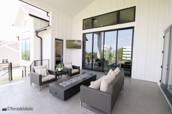 Symmetrical outdoor lounge space. SLPH 2018 Home 9 Alair Homes, Photo by Remodelaholic