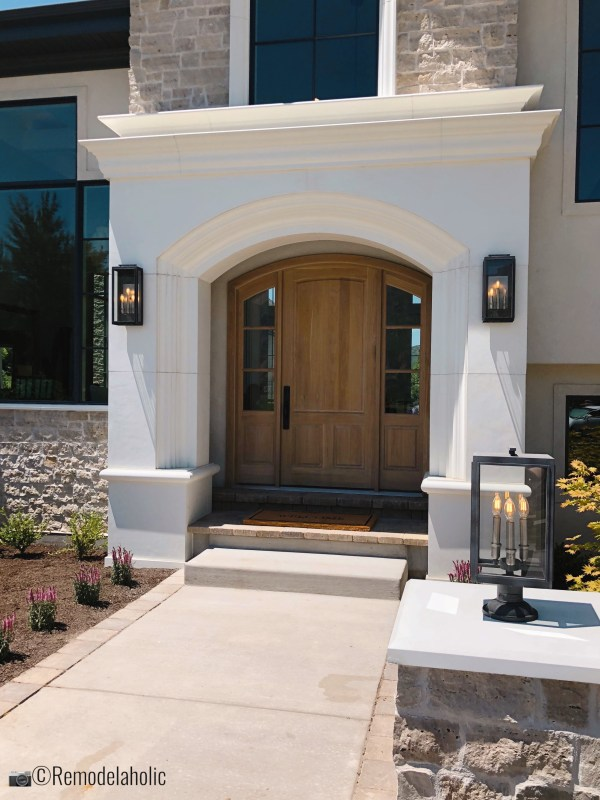 Adding unique outdoor lighting for curb appeal, UVPH 2018 Home 31 Raykon Construction, White + Gold Design, Photo by Remodelaholic