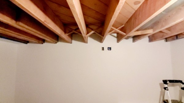 basement remodel with exposed ceiling beam joists