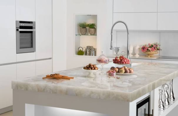 Quartz kitchen island countertop in a white kitchen