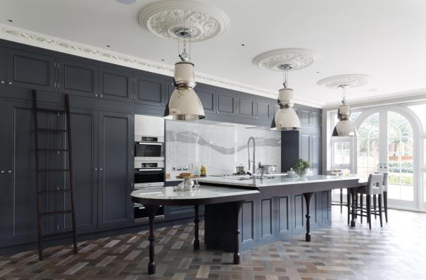 Solid Slab Marble Backsplash in a black kitchen